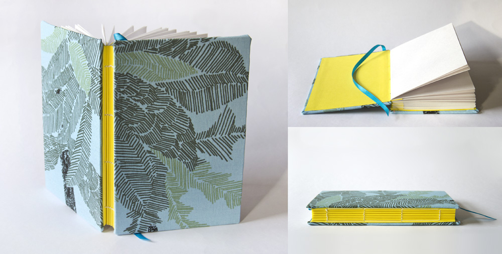 Handmade book with exposed spine and yellow accordion spacing